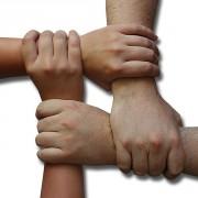 Teamgeist - Hände im Quadrat